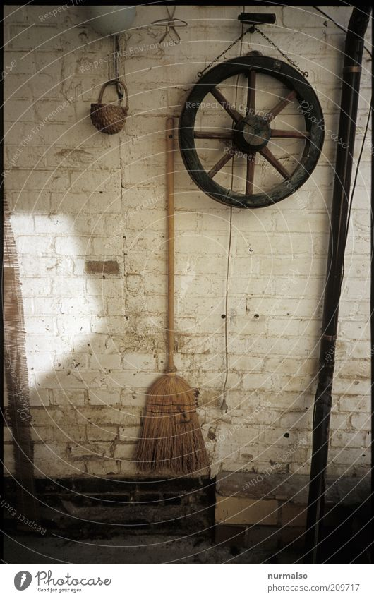 Wheel & Broom Leisure and hobbies Living or residing Decoration Attic Wall (barrier) Wall (building) Stone Wood Witch's broom Old Simple Trashy Moody Stagnating