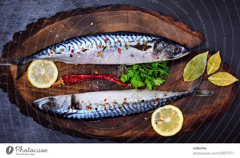 Mackerel in spices Seafood Herbs and spices Nutrition Lunch Dinner Diet Table Restaurant Gastronomy Nature Animal Wood Dark Fresh Natural Green Black Meal Lemon