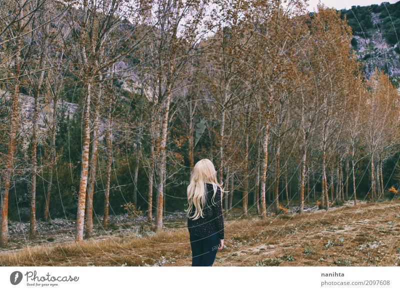Blonde woman alone in a forest Lifestyle Harmonious Senses Relaxation Meditation Human being Feminine Young woman Youth (Young adults) 1 18 - 30 years Adults