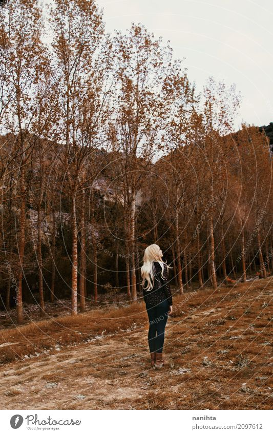 Young woman lost in a forest Human being Feminine Youth (Young adults) 1 18 - 30 years Adults Environment Nature Landscape Autumn Tree Grass Forest Boots Blonde