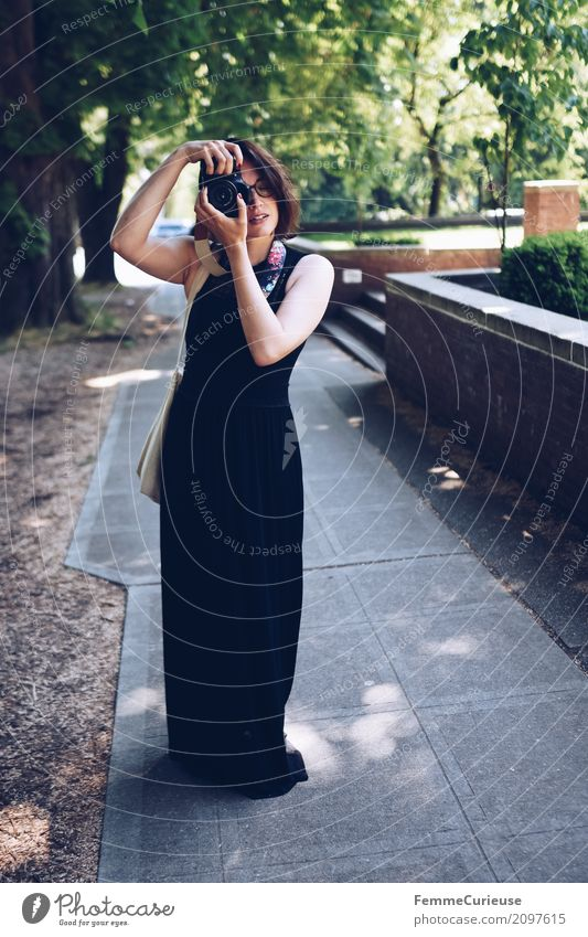 Human being Woman Vacation & Travel Youth (Young adults) Young woman 18 - 30 years Black Adults Feminine Eyeglasses Sidewalk Dress Photographer Take a photo
