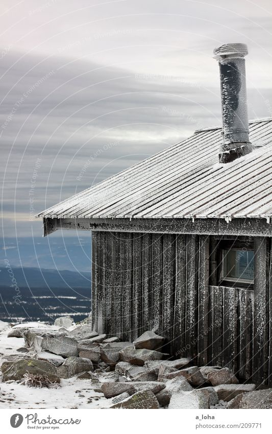 frozen landscape Clouds Winter Bad weather Ice Frost Snow Rock Mountain Deserted Hut Wall (barrier) Wall (building) Roof Chimney Line Stripe Freeze Authentic
