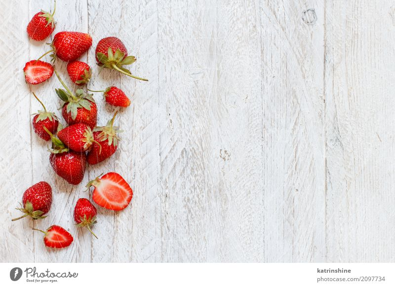 Strawberries on a white wooden table top view Summer Colour Red Natural Wood Brown Bright Fruit Fresh Table Delicious Seasons Dessert Berries Refreshment Diet