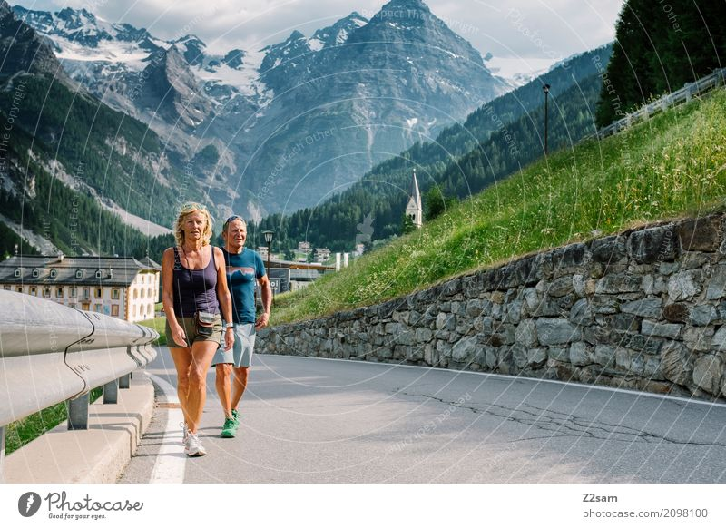 Retired couple hiking in South Tyrol Leisure and hobbies Vacation & Travel Trip Summer vacation Mountain Hiking Couple Partner 45 - 60 years Adults Nature
