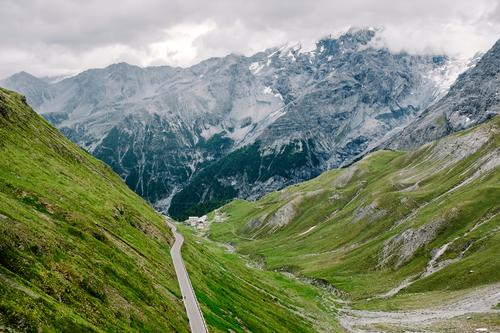 Stelvio Cycling Nature Landscape Summer Bad weather Alps Mountain Peak Glacier Street Overpass Threat Gigantic Tall Natural Green Loneliness Idyll