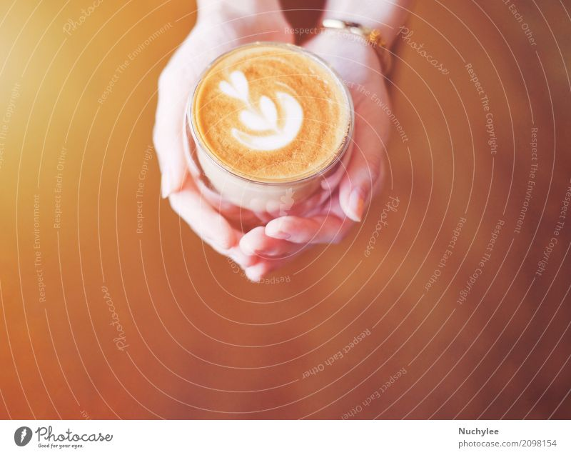 hands of woman holding cup of latte Breakfast Lunch Beverage Coffee Espresso Plate Design Leisure and hobbies Restaurant Woman Adults Hand Art Fresh Hot