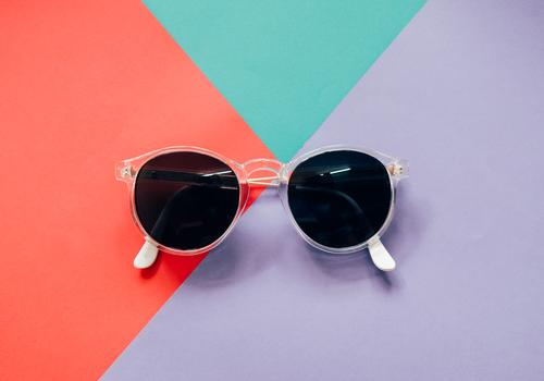Fashionable sunglasses on colorful background Colour White Black Lifestyle Style Business Design Work and employment Copy Space Bright Office Modern Decoration