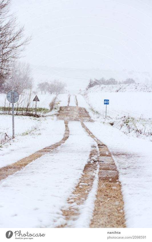 Snowy rural road at winter Environment Nature Landscape Air Sky Winter Climate Climate change Weather Bad weather Storm Snowfall Deserted Transport Road sign