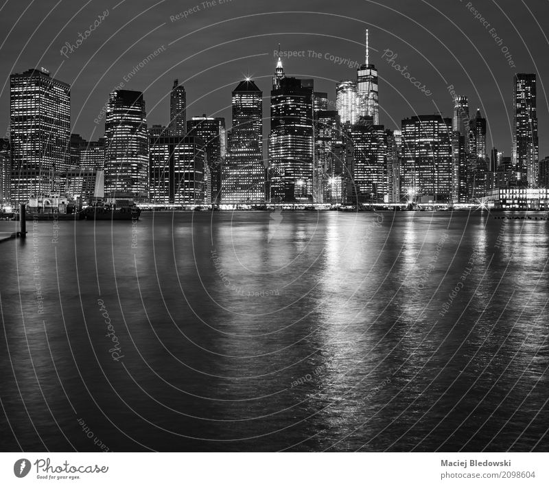 Manhattan skyline reflected in East River at night Vacation & Travel White Black Architecture Building Business Office High-rise USA Illuminate