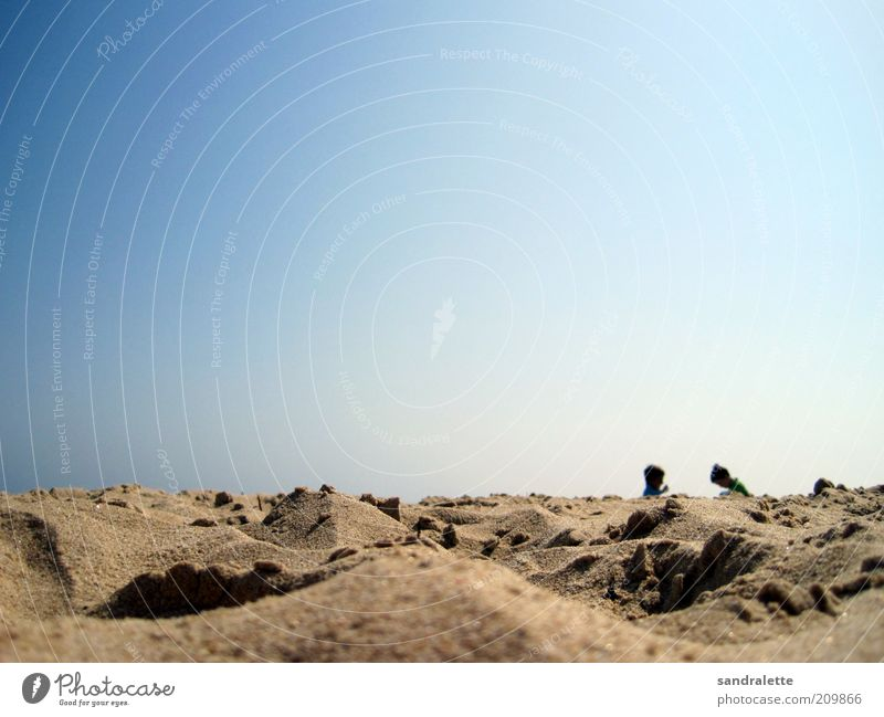 Child Human being Sky Nature Blue Sun Joy Summer Vacation & Travel Beach Playing Boy (child) Sand Warmth Small Infancy