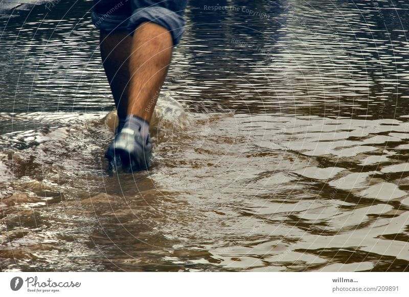 aqua jogging Masculine Legs Feet Elements Water Storm Pedestrian Lanes & trails Jeans Footwear Going Walking Flood Deluge wade Surface of water Water level