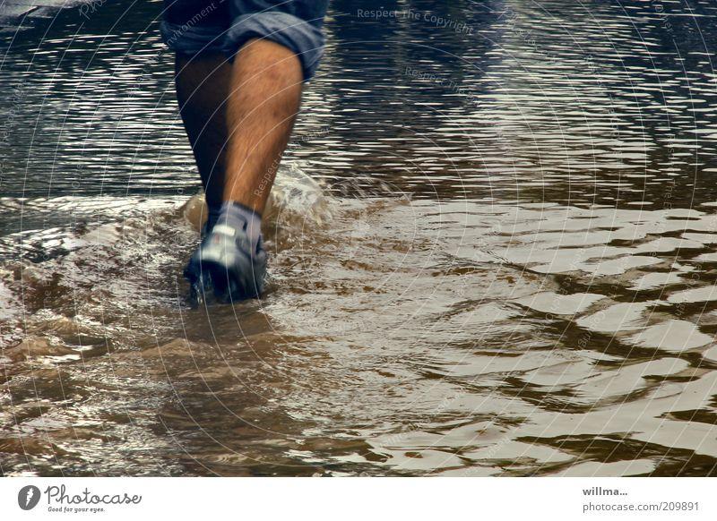 high water Flood Deluge Human being Legs Feet Pedestrian Storm Footwear Going Walking wade Water level Torrents of water Calf Wet Elements