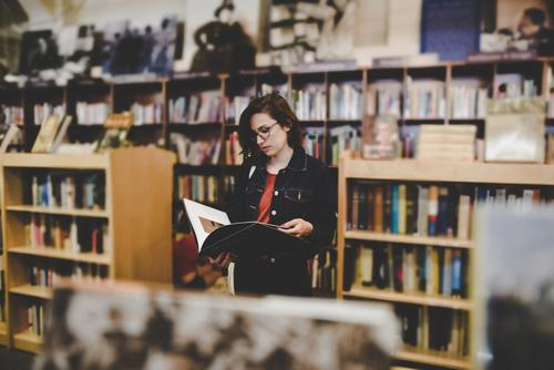Human being Woman Youth (Young adults) Young woman 18 - 30 years Adults Feminine Book Eyeglasses Reading Education Library 30 - 45 years Bookshop Intellectual