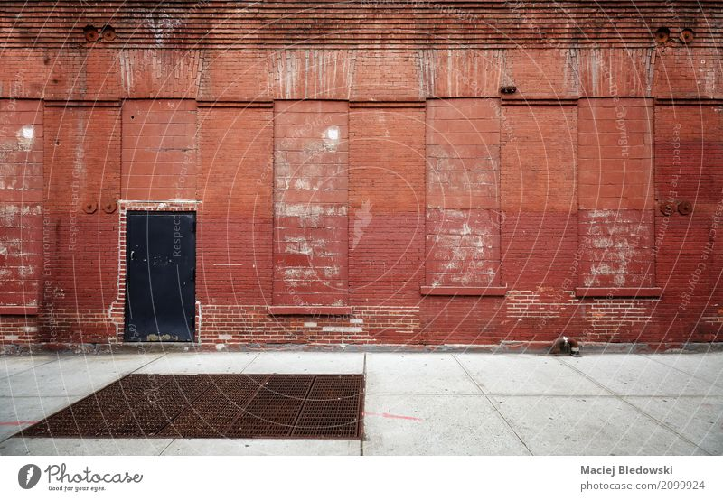Empty street with old warehouse brick wall. Town Deserted Factory Building Architecture Facade Street Old Dirty Red Moody background New York City Brooklyn