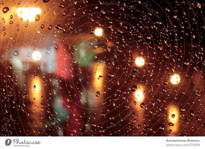 Cold Window Rain Wet Drops of water Illuminate Window pane Street lighting Point of light Bad weather Reluctance Comfortless Night Lighting effect