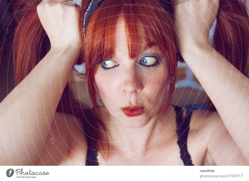 Beautiful, redhead and young woman making a funny face Human being Youth (Young adults) Blue Young woman Red Joy 18 - 30 years Adults Funny Feminine Style Happy