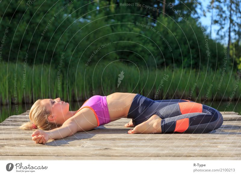 A sporty woman doing yoga and stretching exercises Lifestyle Wellness Sports Yoga Human being Woman Adults 30 - 45 years Nature Park Fashion Blonde Fitness