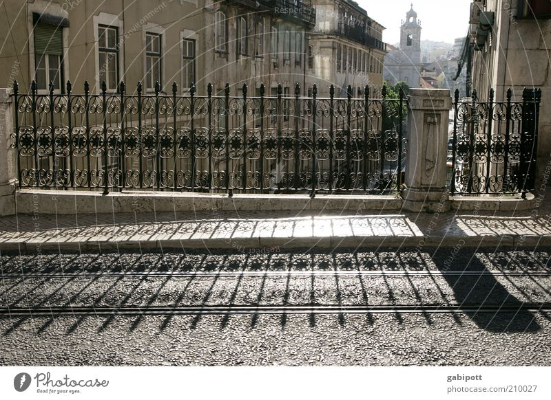 Lisbon early evening Downtown Old town Street Lanes & trails Bridge railing Shadow Shadow play Historic Town Joie de vivre (Vitality) Stagnating Symmetry