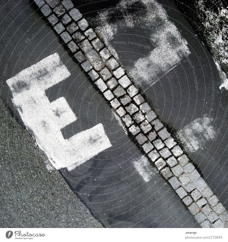 e Subculture Transport Lanes & trails Characters Graffiti Exceptional Under Town Paving stone Asphalt Black & white photo Exterior shot Structures and shapes
