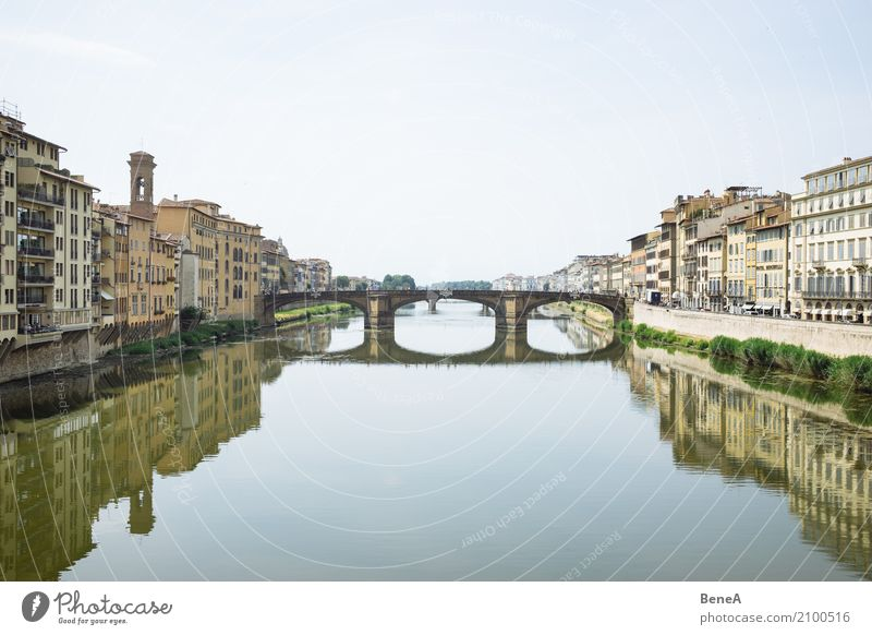Ponte Santa Trinita in Florence reflected in the Arno River Vacation & Travel Tourism Sightseeing City trip Italy Europe Town Capital city Downtown Skyline