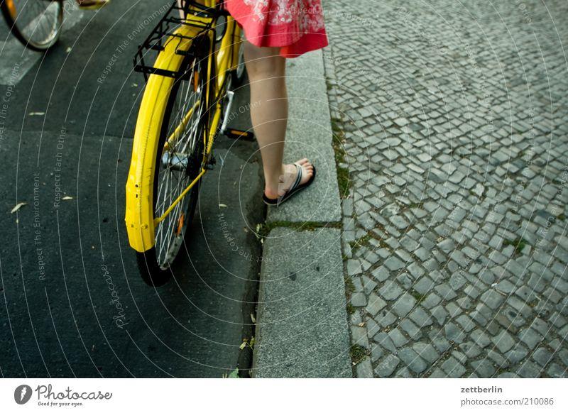 Human being Woman Summer Adults Legs Feet Bicycle Wait Transport Stand Driving Dress Sidewalk Skirt Cobblestones Wheel