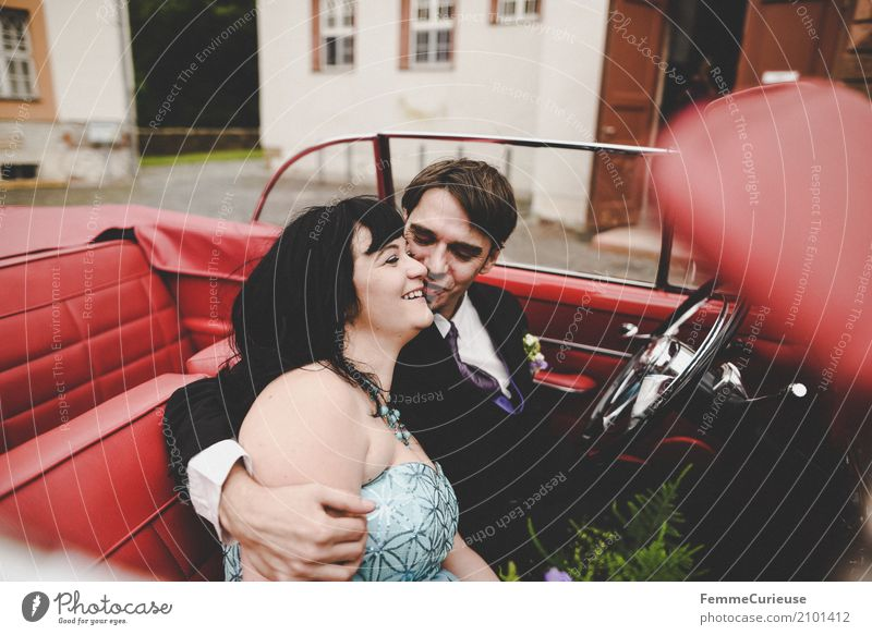 Human being Woman Youth (Young adults) Man Red Joy 18 - 30 years Adults Feminine Happy Masculine Car Wedding Kissing Motoring Embrace