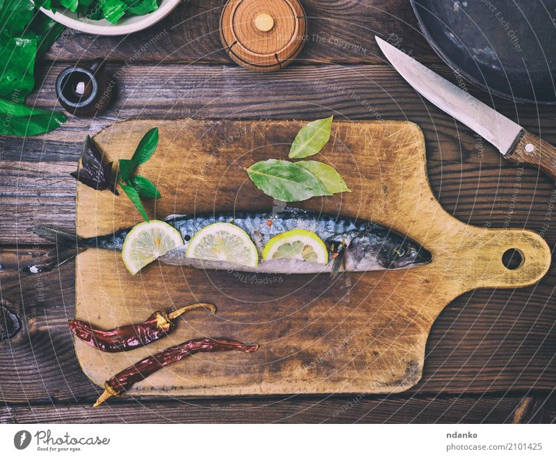 mackerel on a wooden kitchen board Green Ocean Animal Dark Black Natural Wood Nutrition Fresh Table Fish Herbs and spices Kitchen Gastronomy Restaurant Dinner