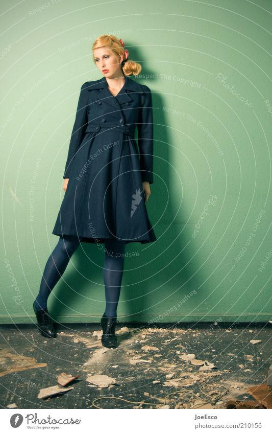 green and blue 02. Lifestyle Style Beautiful Flat (apartment) Human being Woman Adults Wall (barrier) Wall (building) Fashion Coat Tights Blonde Braids