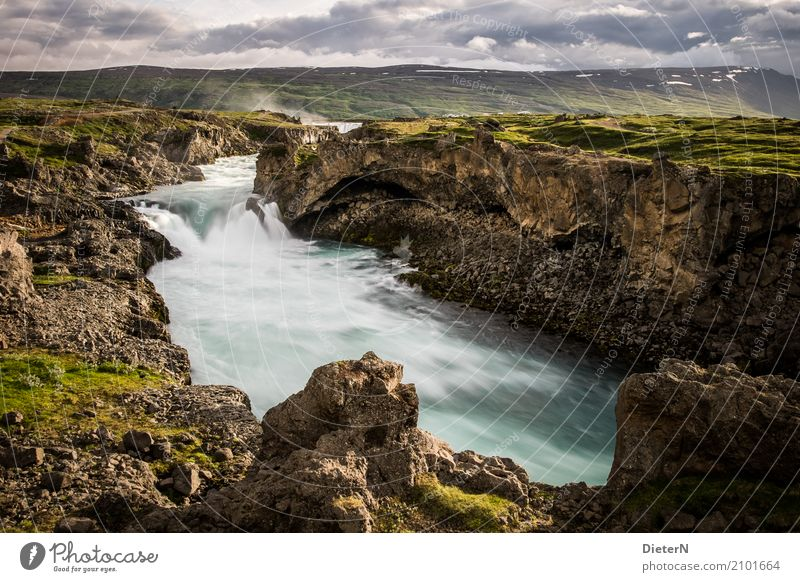 buried Environment Landscape Water Sky Clouds Summer Weather Beautiful weather Rock Canyon River bank Brook Brown Green Turquoise Iceland Waterfall Gullfoss
