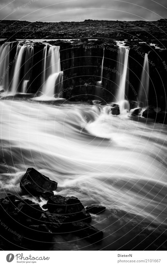 sellfoss Environment Nature Landscape Water Sky Clouds Weather Bad weather Rock Waves River bank Waterfall Gray Black White Iceland Black & white photo