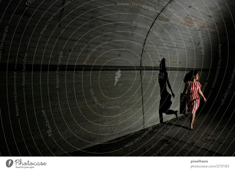 Run! Run as fast as you can! [..] Feminine Young woman Youth (Young adults) Woman Adults 1 Human being 18 - 30 years Deserted Tunnel Manmade structures