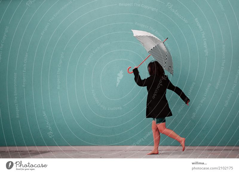 woman in short trousers and with umbrella walks barefoot in front of a neutral background Human being Feminine Woman Adults 1 Jacket Umbrella Black-haired