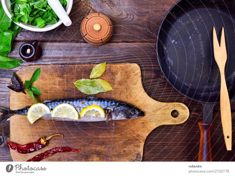 fresh mackerel Seafood Herbs and spices Nutrition Lunch Dinner Diet Pan Spoon Ocean Table Kitchen Restaurant Gastronomy Animal Wood Dark Fresh Natural Green
