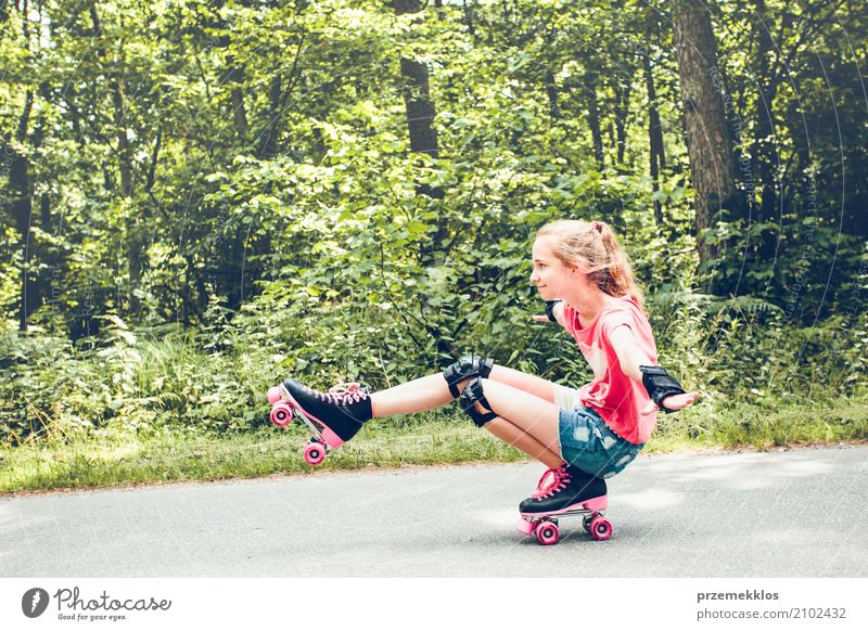 Young girl roller skating down on a forest road Lifestyle Joy Happy Relaxation Vacation & Travel Freedom Summer Sports Child Human being Girl