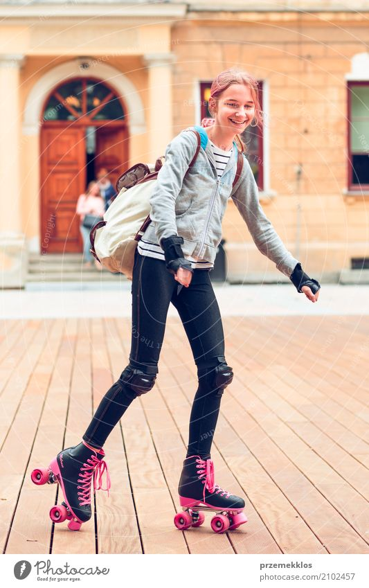 Young girl roller skating in a town spending time actively Human being Child Vacation & Travel Youth (Young adults) Summer Town Relaxation Joy Girl Lifestyle Sports Happy 13 - 18 years Action To enjoy Small Town