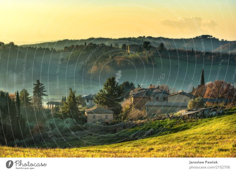 Fields and buildings in the mist at sunset. Beautiful Vacation & Travel Mountain House (Residential Structure) Environment Nature Landscape Plant Clouds Autumn
