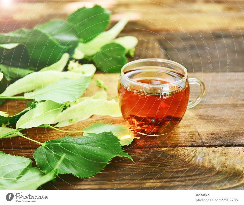Herbal tea with linden Breakfast Hot drink Tea Cup Mug Table Leaf Wood Fresh Brown Green herbal Transparent branch vintage Useful Tasty sunny Colour photo