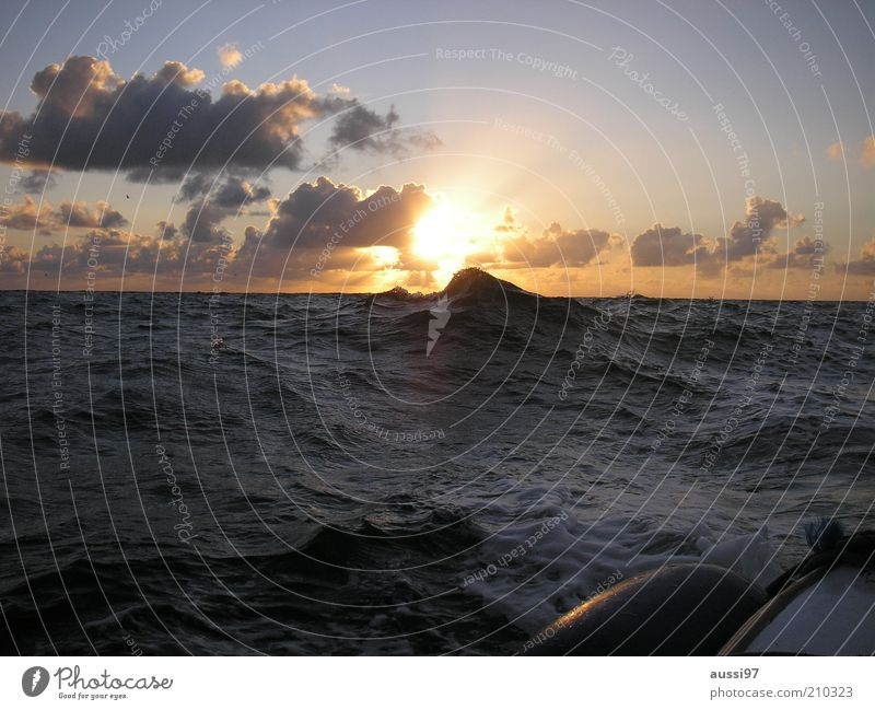 Sky Sun Ocean Clouds Lake Watercraft Waves Driving North Sea Nature Agitated Water Sunset Movement Elements Evening sun