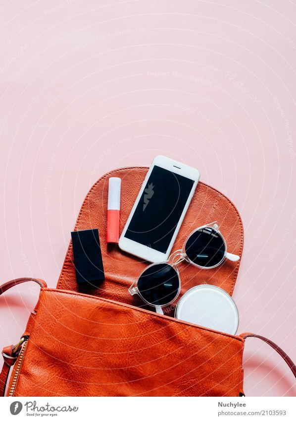 Flat lay of leather woman bag Elegant Style Design Beautiful Skin Make-up Lipstick Vacation & Travel Telephone PDA Technology Feminine Woman Adults Hand Fashion