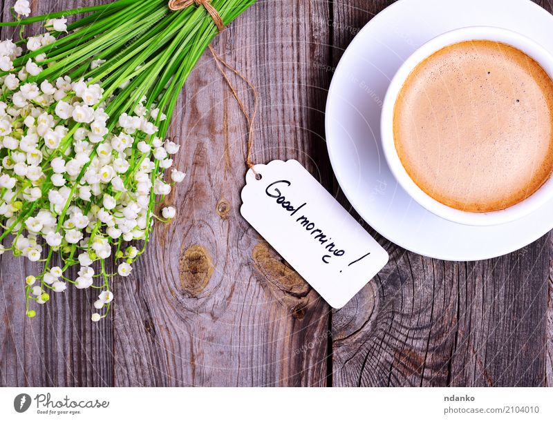 Cup of cappuccino and bouquet Breakfast To have a coffee Hot drink Coffee Espresso Mug Table Restaurant Flower Bouquet Wood Blossoming Fresh Good Above Retro