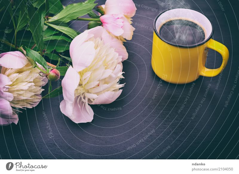 Black coffee in a yellow mug Breakfast To have a coffee Beverage Coffee Espresso Cup Table Restaurant Flower Bouquet Wood Fresh Hot Above Retro Yellow Pink