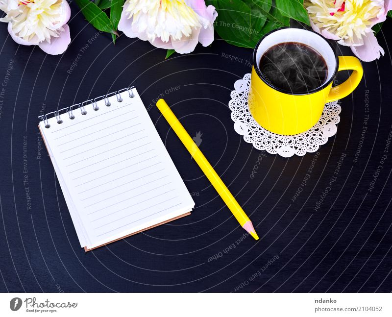 Empty notebook and yellow mug Breakfast To have a coffee Hot drink Coffee Cup Mug Nature Plant Flower Paper Wood Bright Above Yellow Pink Black White Pencil