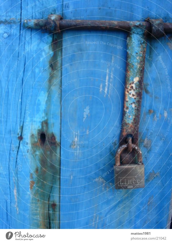 hang out Padlock Safety Bombproof Closed Defensive Archaic Things Rust Old Blue Wooden door Shabby Weathered Cobalt blue Protection