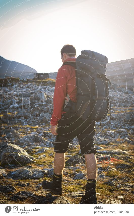 Portrait of a young man with a hiking backpack, Norway Vacation & Travel Adventure Freedom Hiking Young man Youth (Young adults) Nature Rock Hut Wild