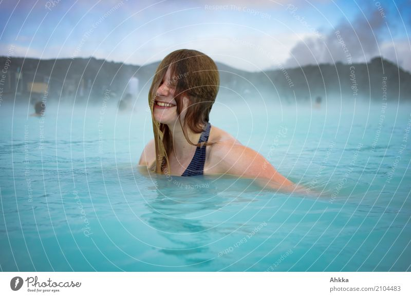 Young woman laughs in the Blue Lagoon Joy Happy Beautiful Wellness Life Harmonious Well-being Contentment Senses Relaxation Calm Swimming pool