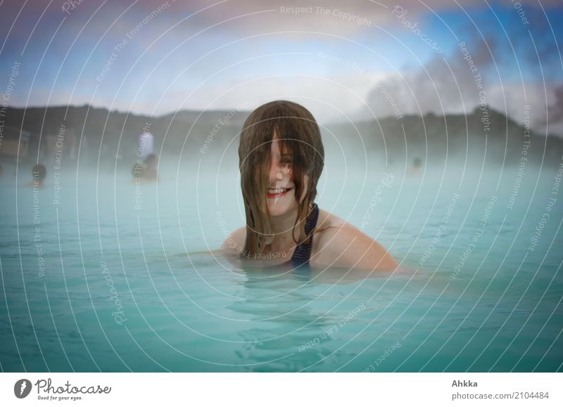 Young woman bathing in the Blue Lagoon Beautiful Wellness Harmonious Well-being Contentment Senses Relaxation Calm Spa Steam bath Whirlpool Swimming & Bathing