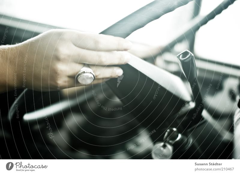 Maria steers the bus Feminine Hand Fingers Steering Steering wheel Ring Natural Car Driving Transport Interior shot Shallow depth of field Women`s hand Motoring