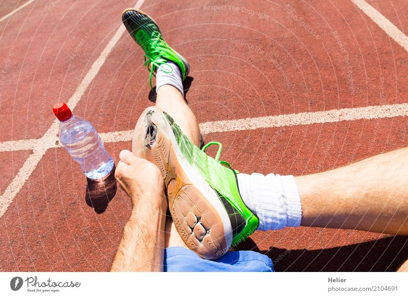 Athletes with broken green racing shoes Sports Sportsperson Jogging Racecourse Masculine Man Adults Hand Legs Feet 1 Human being 30 - 45 years Stockings