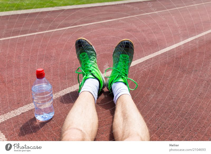 Athlete with green racing shoes and water bottle Bottle Sports Sportsperson Jogging Racecourse Human being Masculine Man Adults Legs Feet 1 30 - 45 years