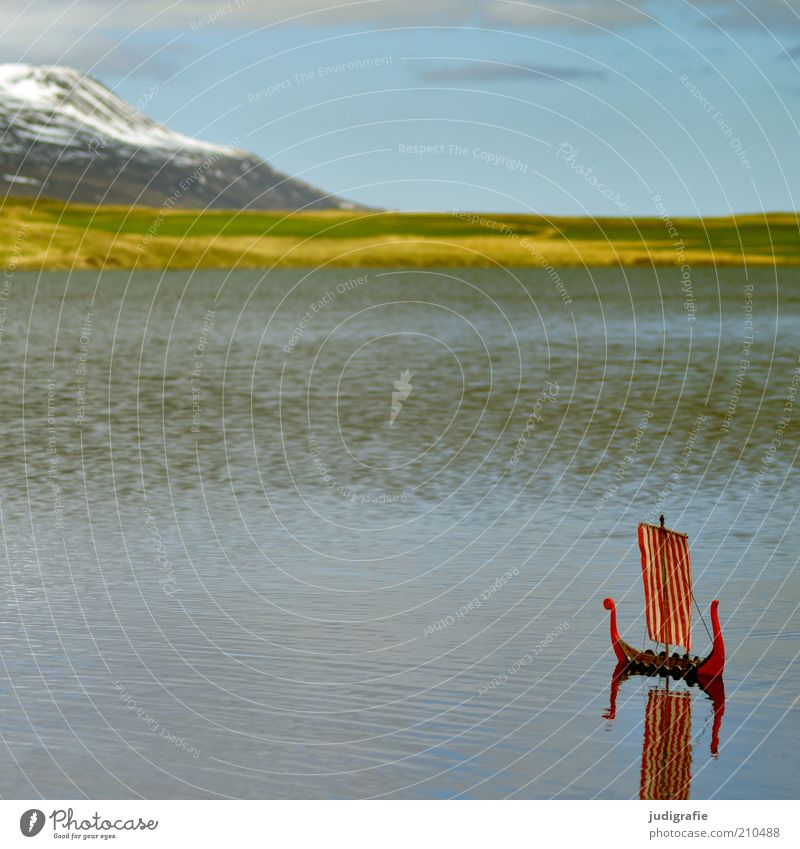 Nature Water Sky Red Vacation & Travel Loneliness Far-off places Meadow Mountain Lake Landscape Watercraft Moody Environment Rock Adventure